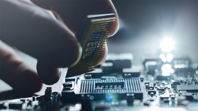 Closeup of person inserting computer chip