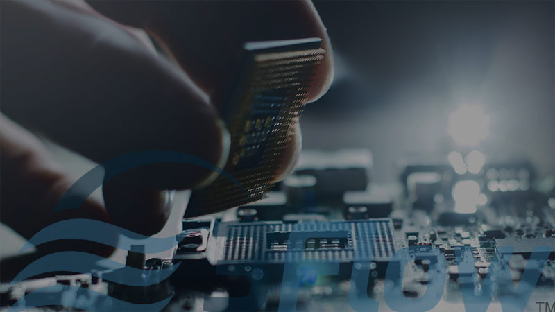 Closeup of person inserting computer chip with dark overlay and 3Flow logo