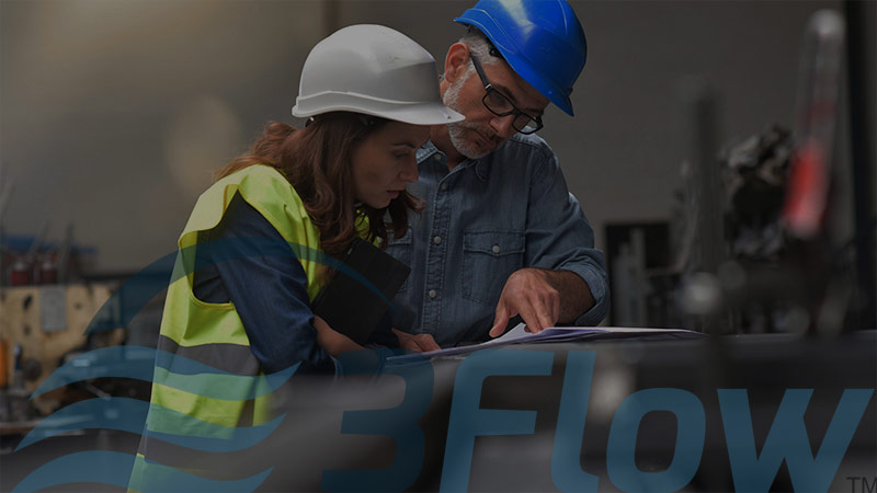 Man and woman wearing hard hats and looking at documents with dark overlay and 3Flow logo