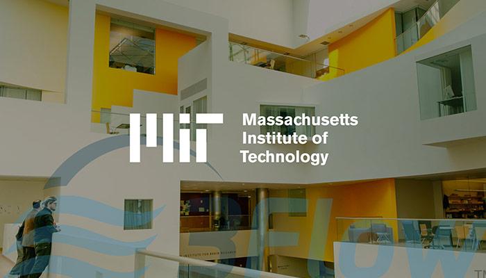 MIT logo over darkened photo of their building lobby