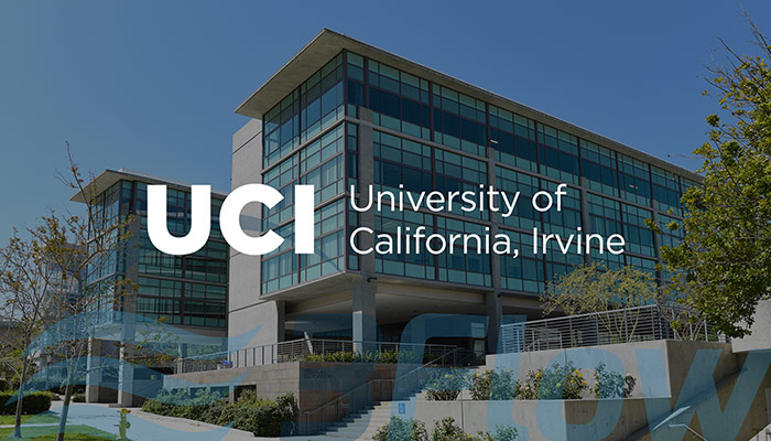 UCI logo over darkened photo of their building
